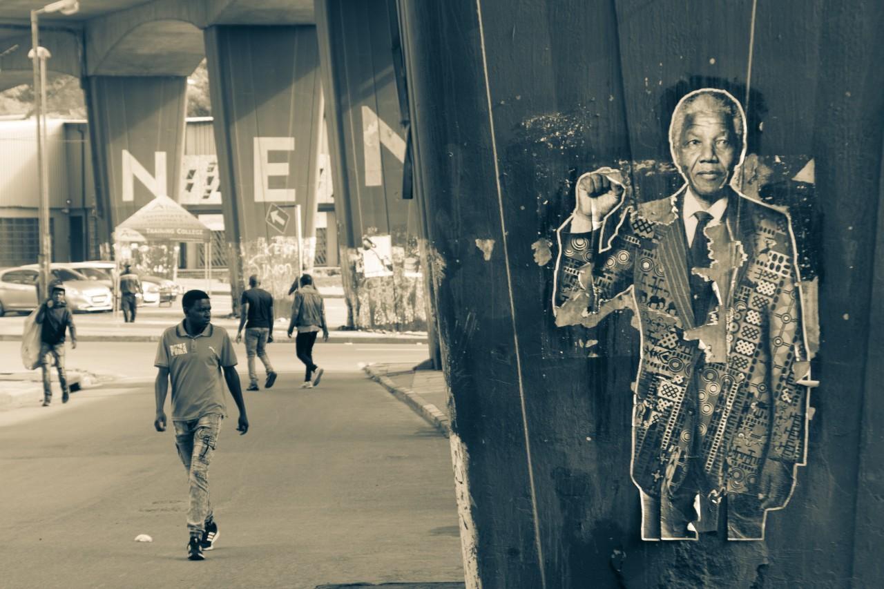 poster of Mandela on street